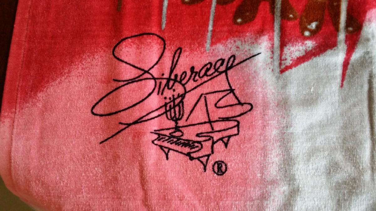 Liberace Trademark Signature on Rockettes beach towel